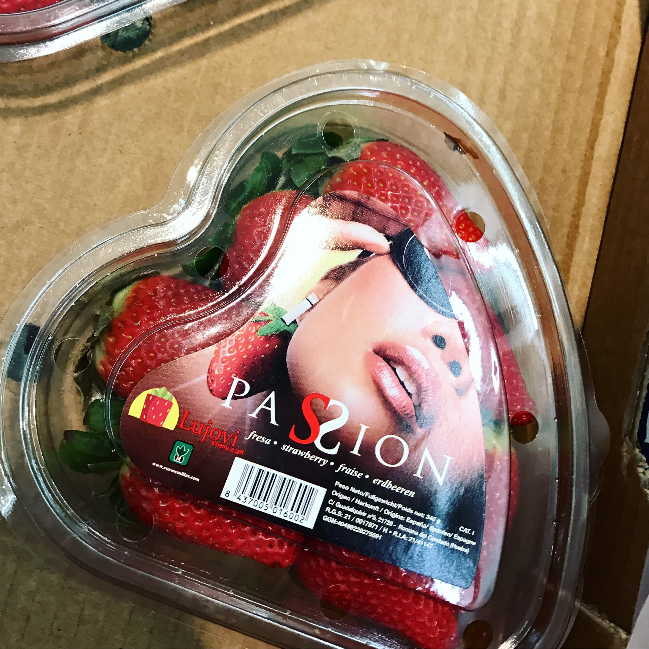 VERY luxurious strawberries at the local grocery store. Very passionate and I wish I had a clip on strawberry earring like her.