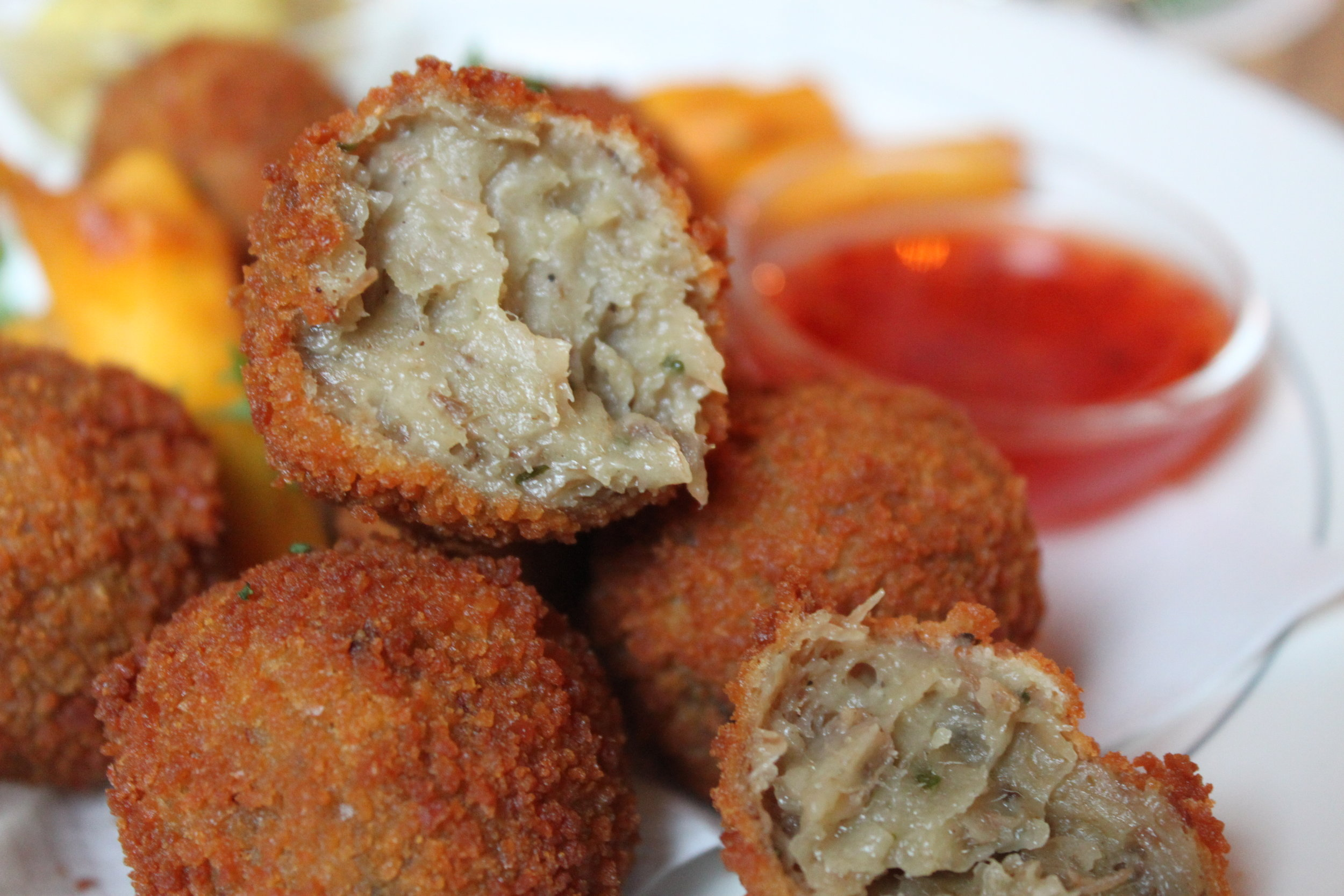 This is a bitterballen. This is the questionable meat I speak of. Yuck. I need to hurry up and write this so I can stop looking at it.
