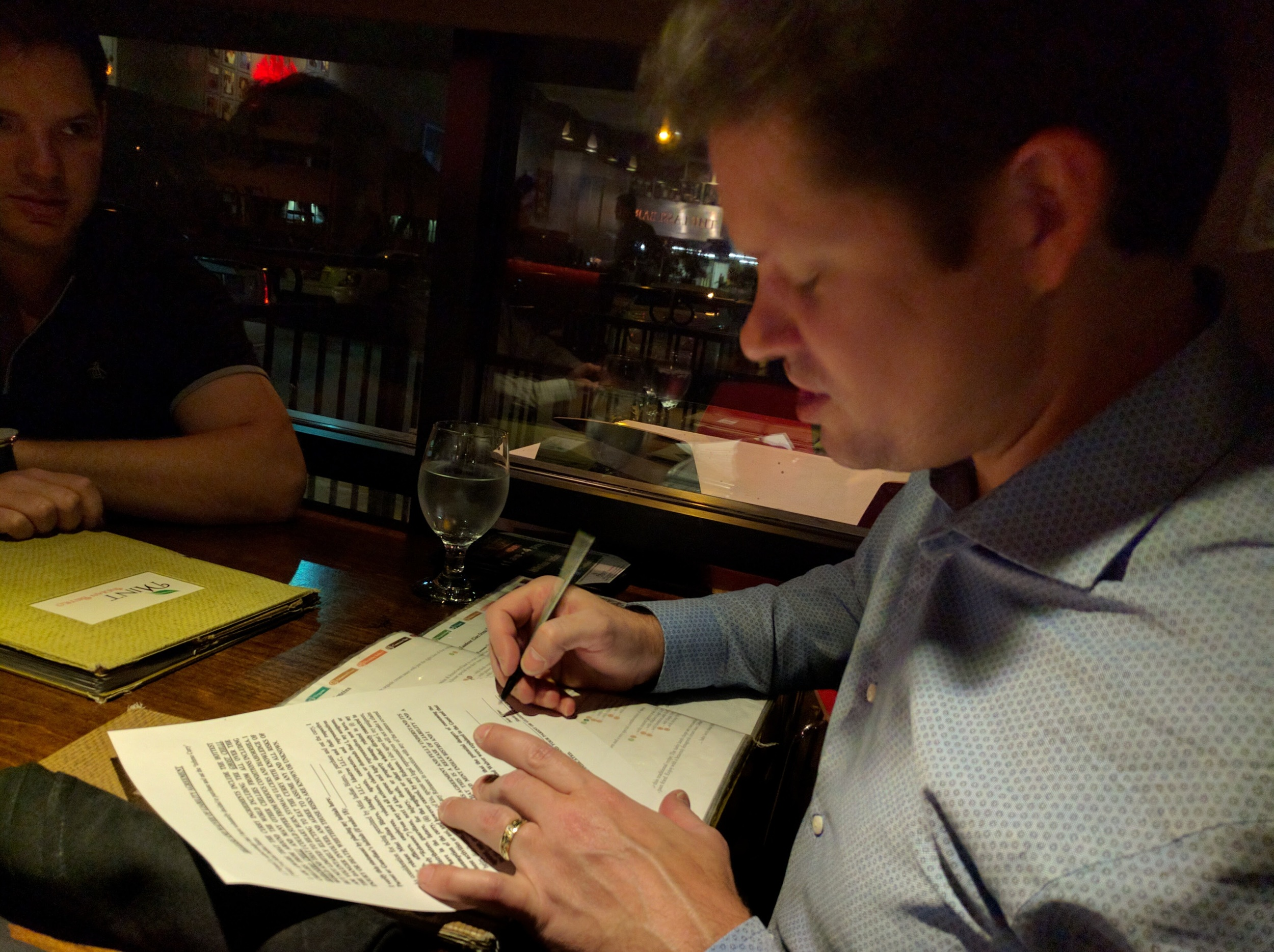 Charles signing his life away for Naan bread...seriously!