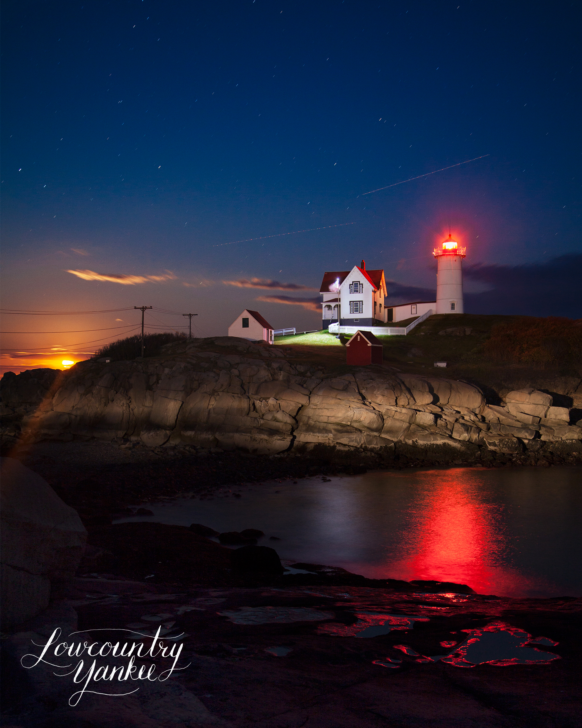 The moon rising behind the Nubble Lighthouse.  York, ME