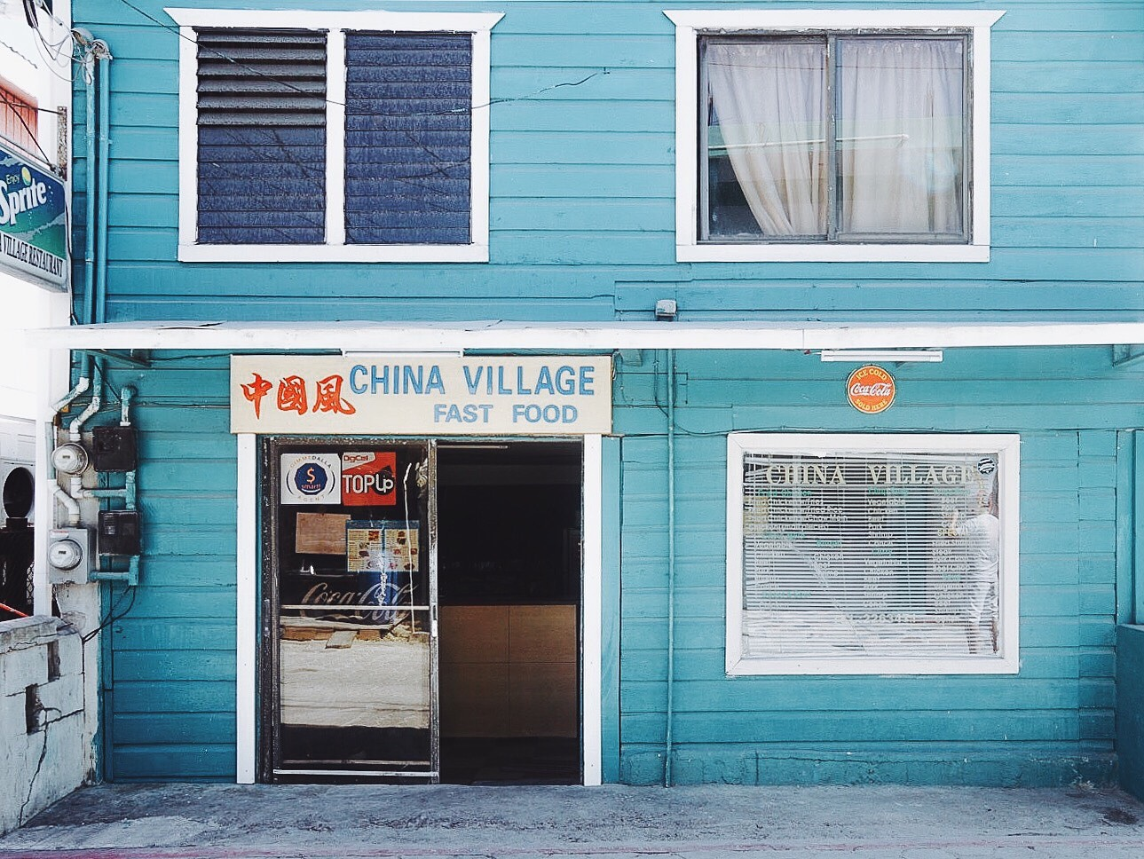 The shops of Belize were saturated with color. This teal shopfront was my favorite - the color of the ocean just a block away. I wish I had tried some Belizean Chinese food because there's a large Chinese population here.
