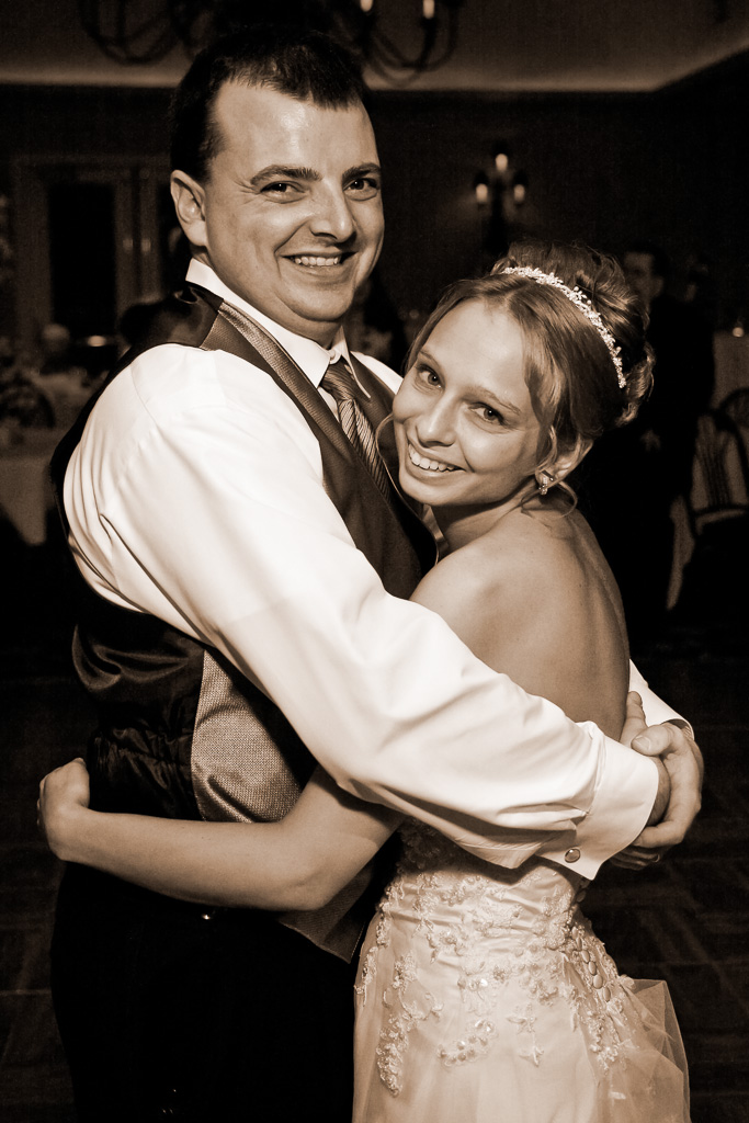 Sepia photograph of a bride and groom during first dance