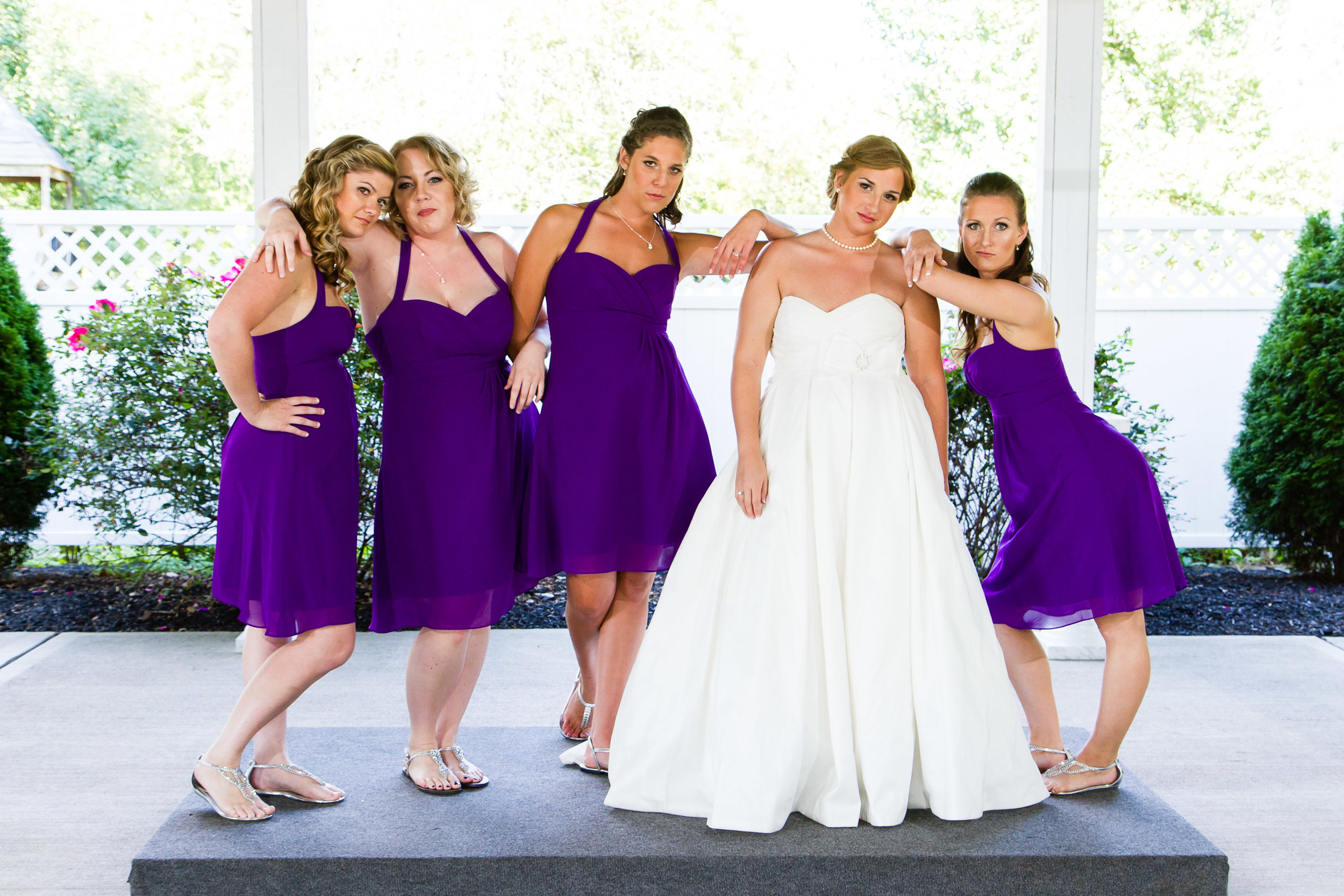Wedding photograph of a bride with bridesmaids