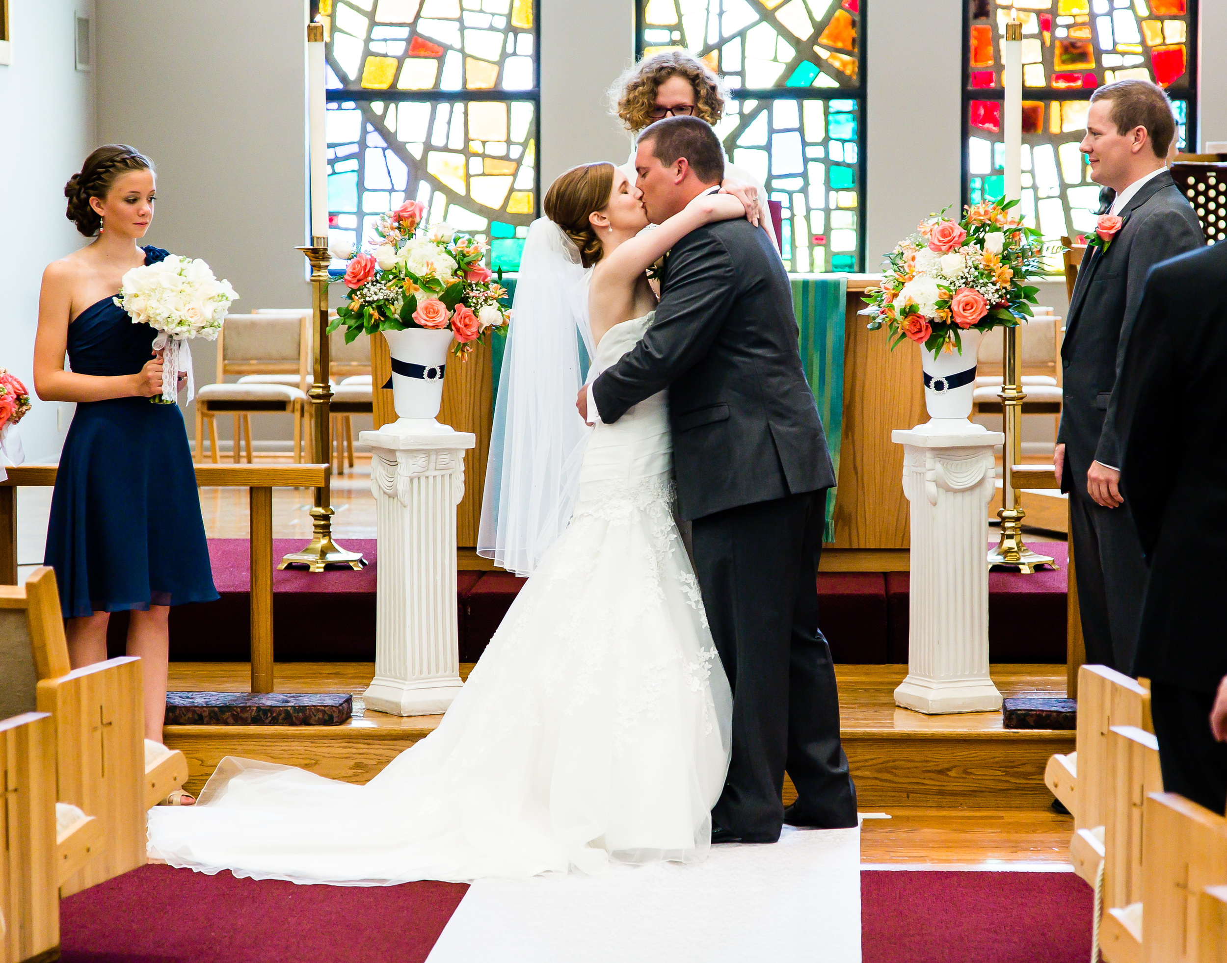 Photograph of bride and groom first kiss