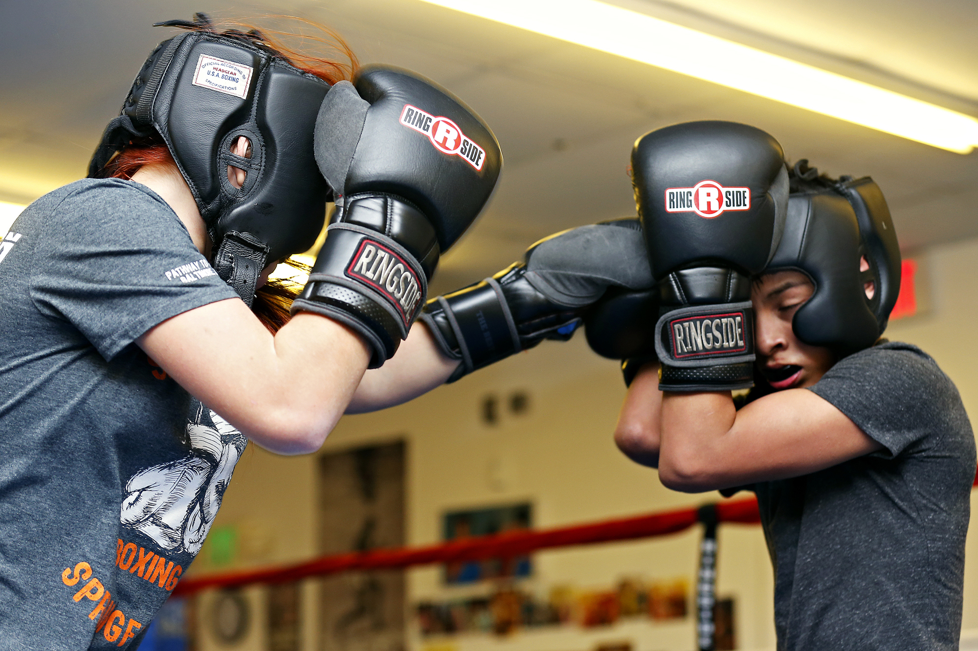 """Shilyn Bradt spars with Luis Velasquez at Smitty's Midwest Boxing Gym in Springfield, Mo. on Feb. 4, 2016. The only lingering effects from her past health struggles are having an inability to vomit or burp due to her stomach being tied around her esophagus, and a sharp pain if she ever takes a hit to what is now a long scar in her stomach. """"Oh, gosh, it hurts a lot,""""said Bradt. """"I don't know how it's going to react if I get hit there too many times."""""""