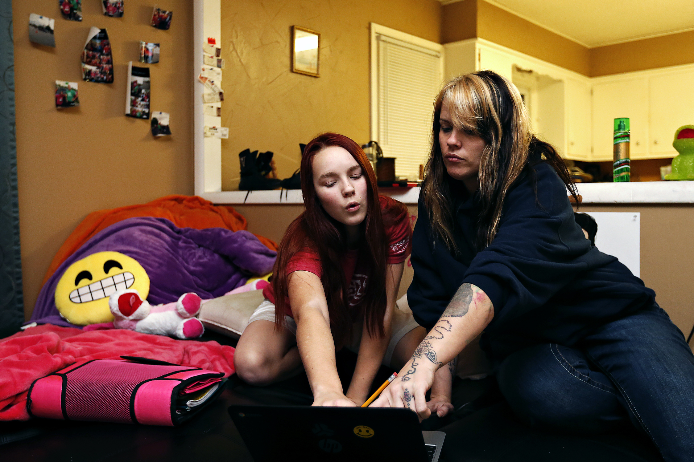 Shilyn Bradt and her mother Heather Bradt-Kingsley work on Bradt's homework at their home in Springfield, Mo. on Feb. 9, 2016.Through Shilyn's health struggles, Heather kept hope that her daughter would survive and grow up normally, which she is doing now.