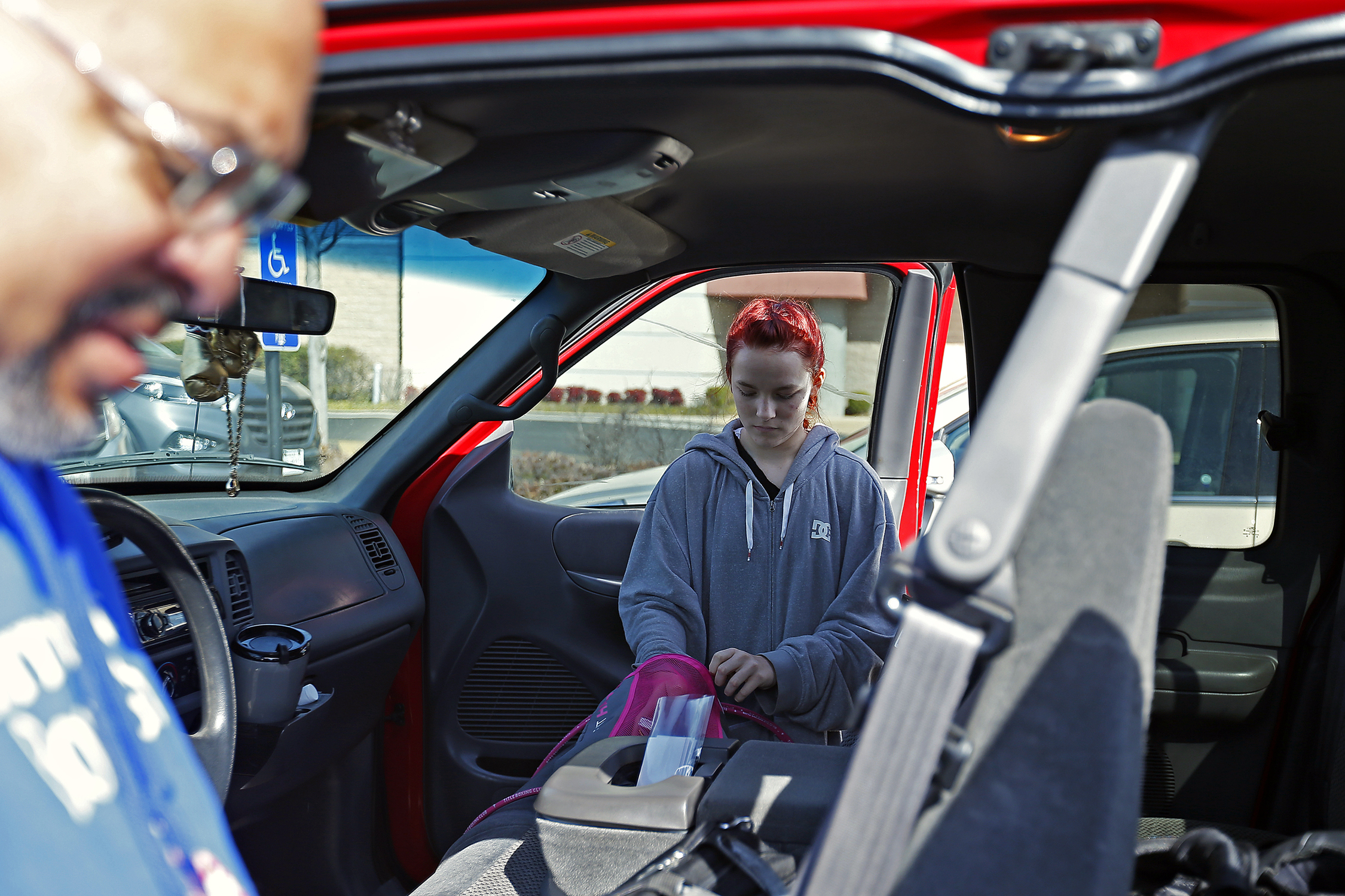 Shilyn Bradt grabs her backpack from coach Darrell Smith's truck during the first day of registration of the Sugar Bert Boxing Title Belt National Qualifier at the Branson Convention Center in Branson, Mo. on March 4, 2016. The tournament would reward its winners with a trip to the Sugar Bert Boxing Title Belt National Championship in November.
