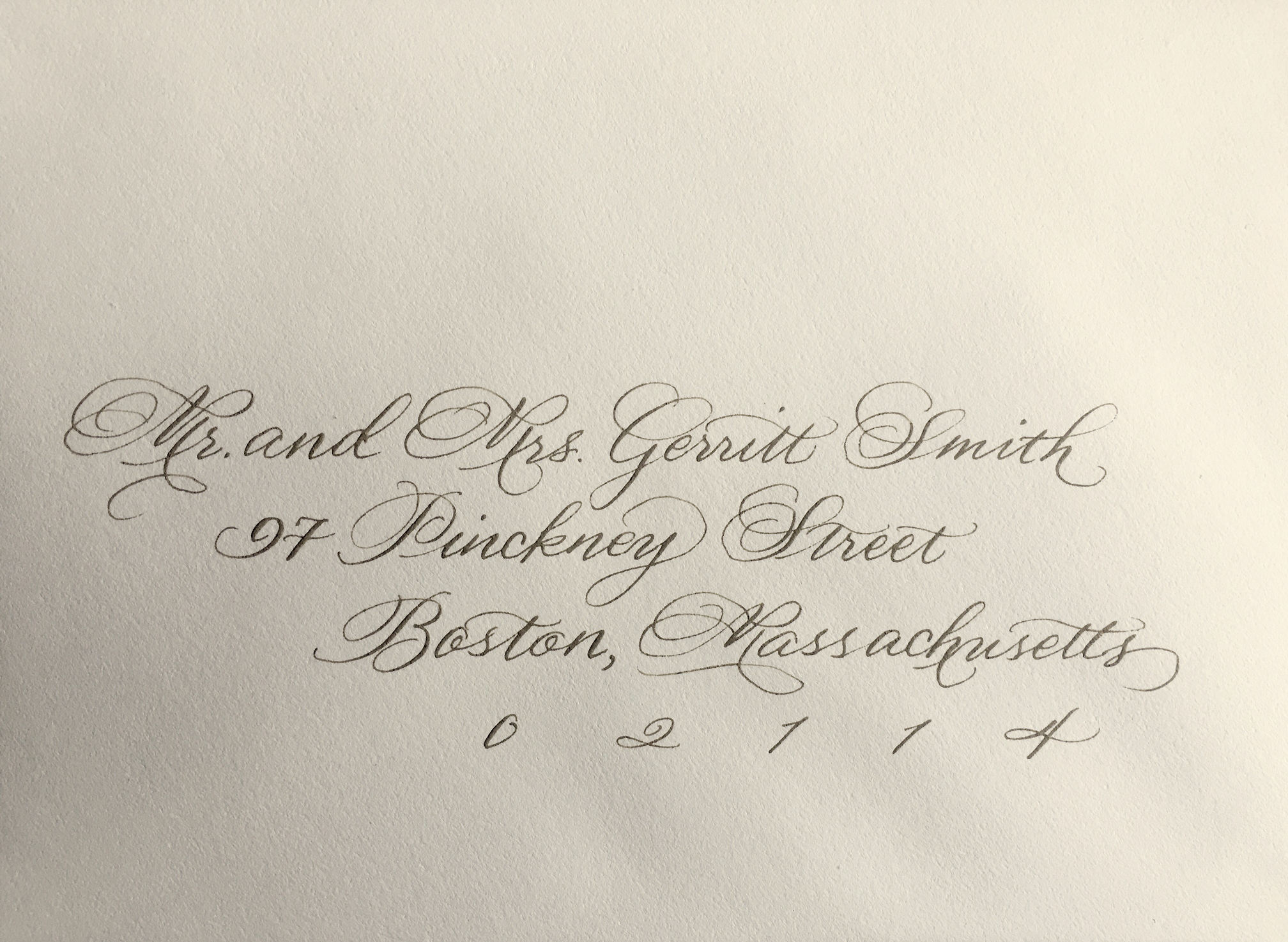 Envelope addressed in Copperlate with ornate flourishes.