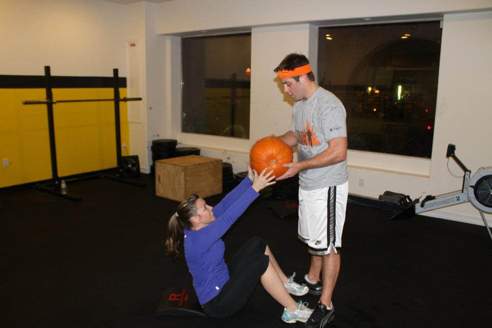 Katie and Rob doing a partner pumpkin WOD 3 years ago at CFR