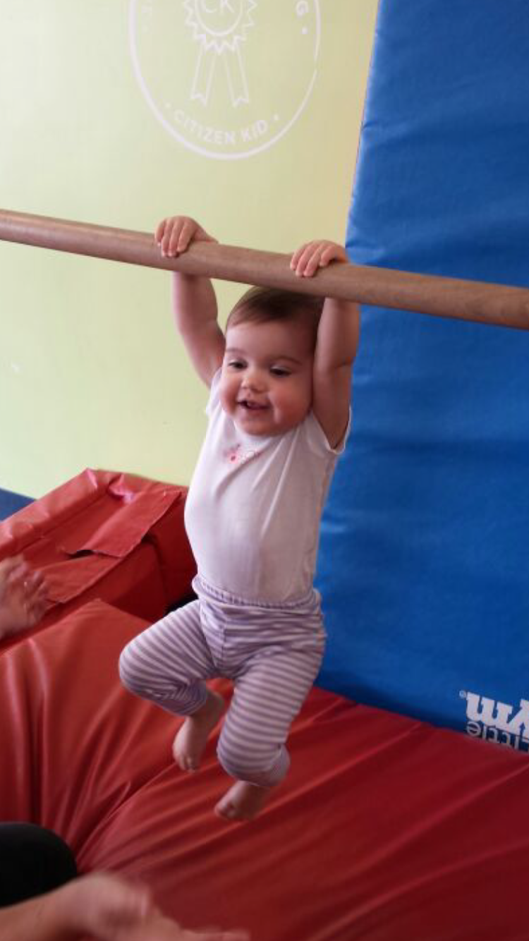 Sam is getting her gymnastics down so she can join the CrossFit Kids class when she is 3!