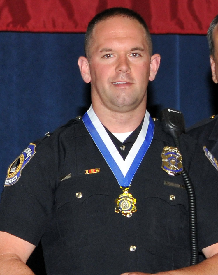 Officer David S. Moore, 29, of the Indianapolis Metropolitan Police Department, died on January 26, 2011 from gunshot wounds suffered on January 23, 2011 when he stopped a stolen vehicle and the driver opened fire at him. He is survived by his mother Jo Ann, father Spencer, and sister Carol Bongfeldt