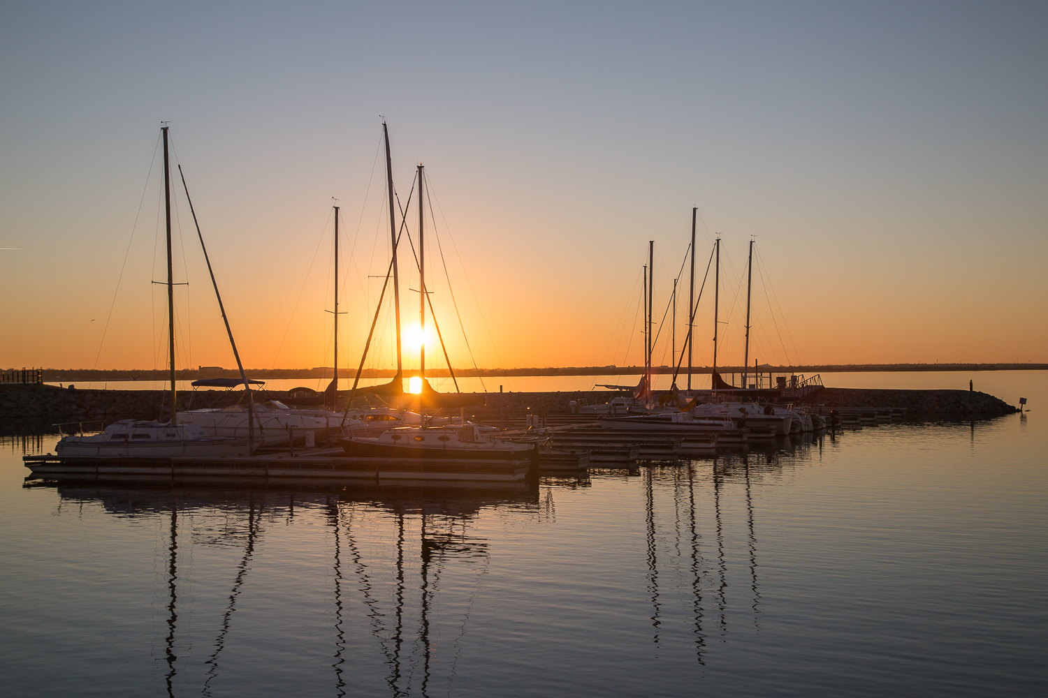 Sunset over sail boats