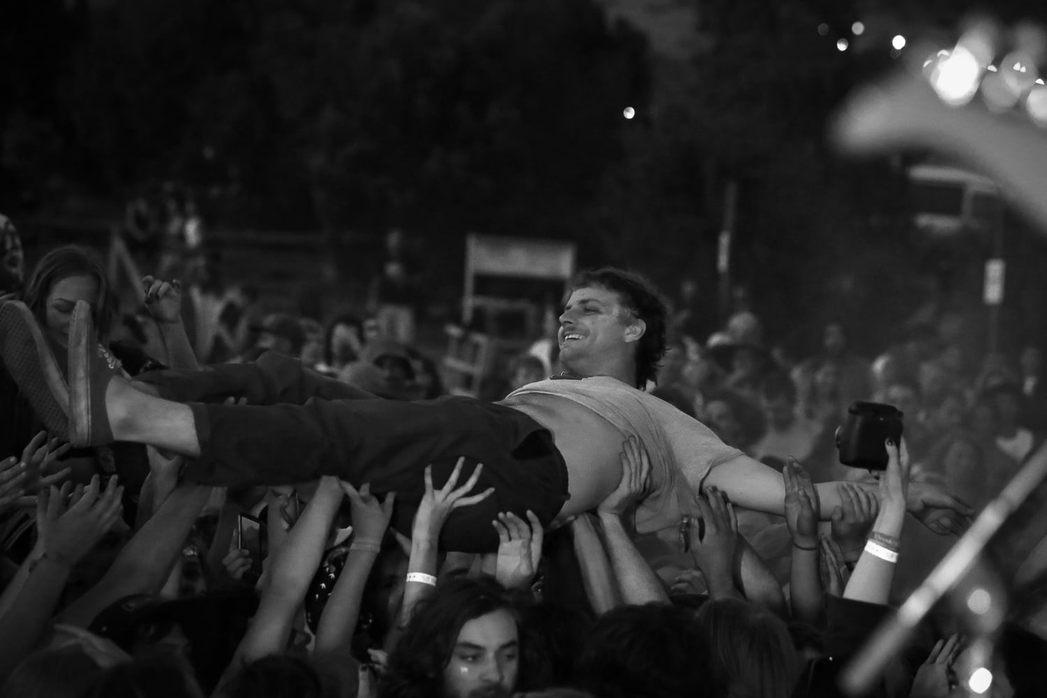 Mac Demarco surfing during King Gizzard and the Lizard Wizard