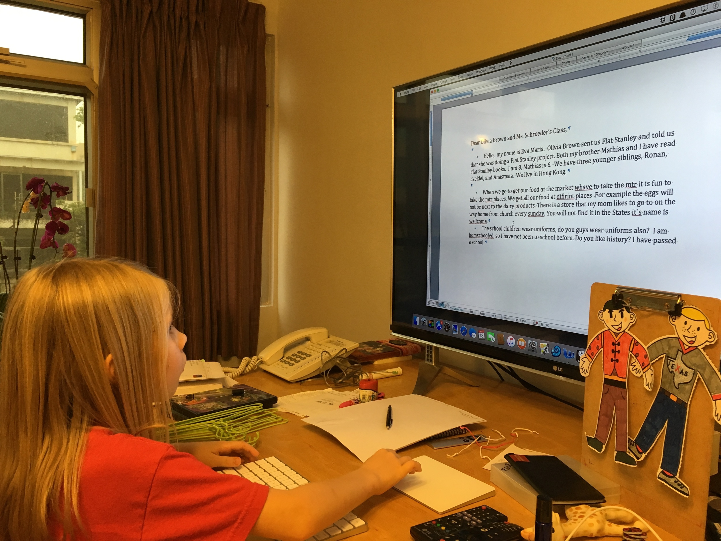 Eva Maria writing her Flat Stanley letter.