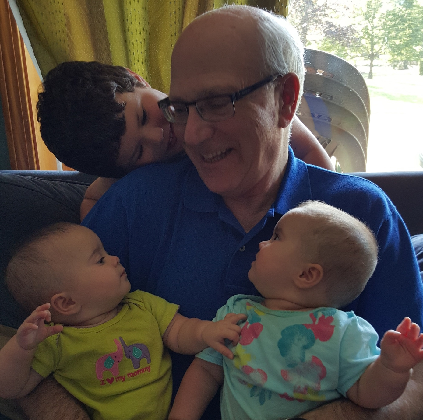 Puppet Showplace Board Treasurer, David Levenson with grandchildren Aaron and identical twins (it's true) Maya (left) and Lillian (right.)