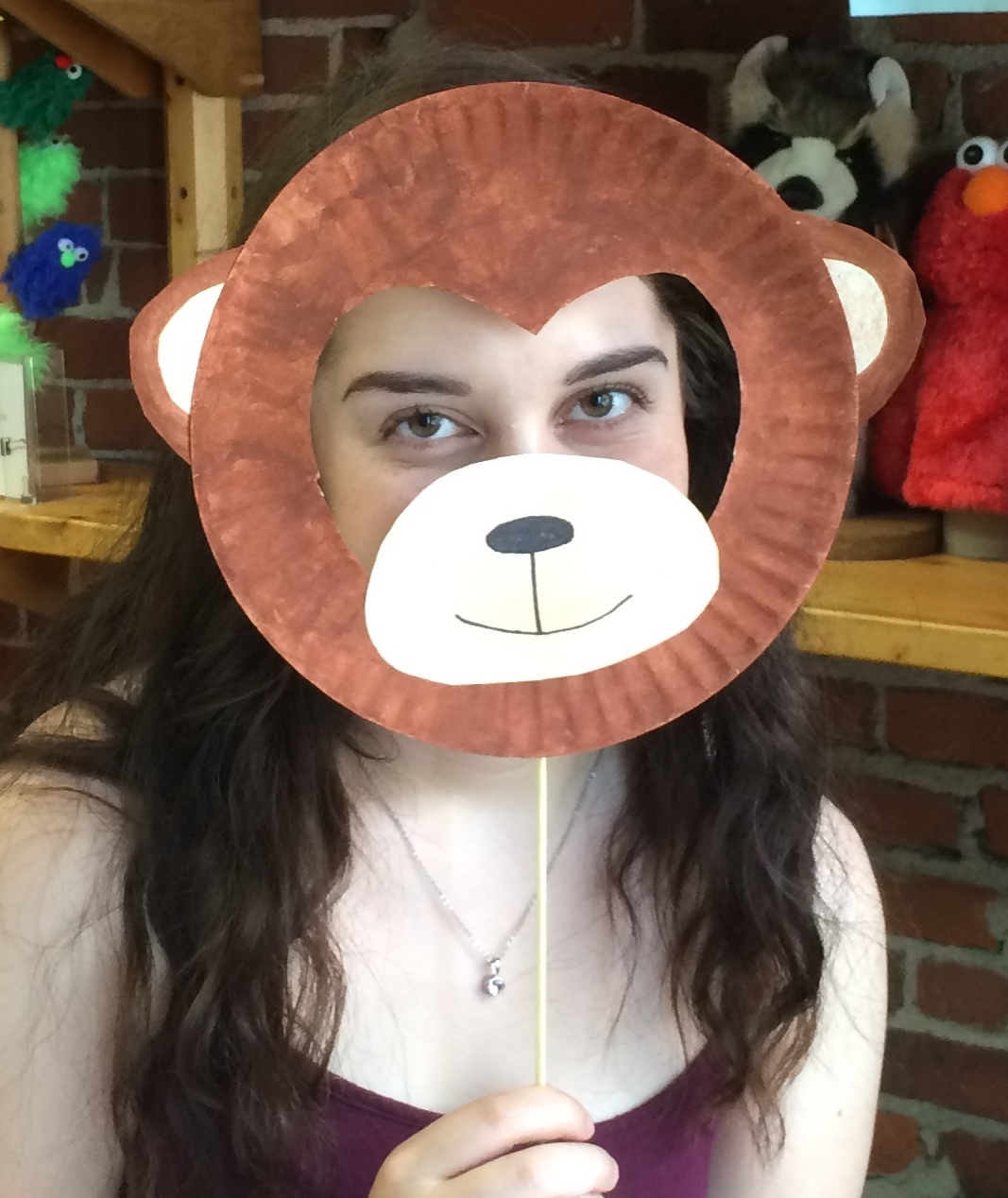 Our intern, Shona, posing with the monkey mask she made.