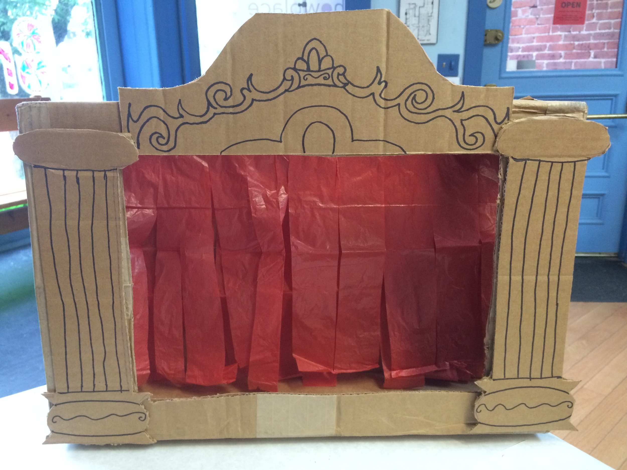 Your completed theatre should look like this. Now you can put on puppet shows of your own! If you recreate this DIY, be sure to share a picture with us on Instagram with the tag #PuppetShowplaceDIY. Happy puppeting!