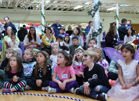 Children eagerly watch a performance at the theater's annual Fairy Tale Tea Party.