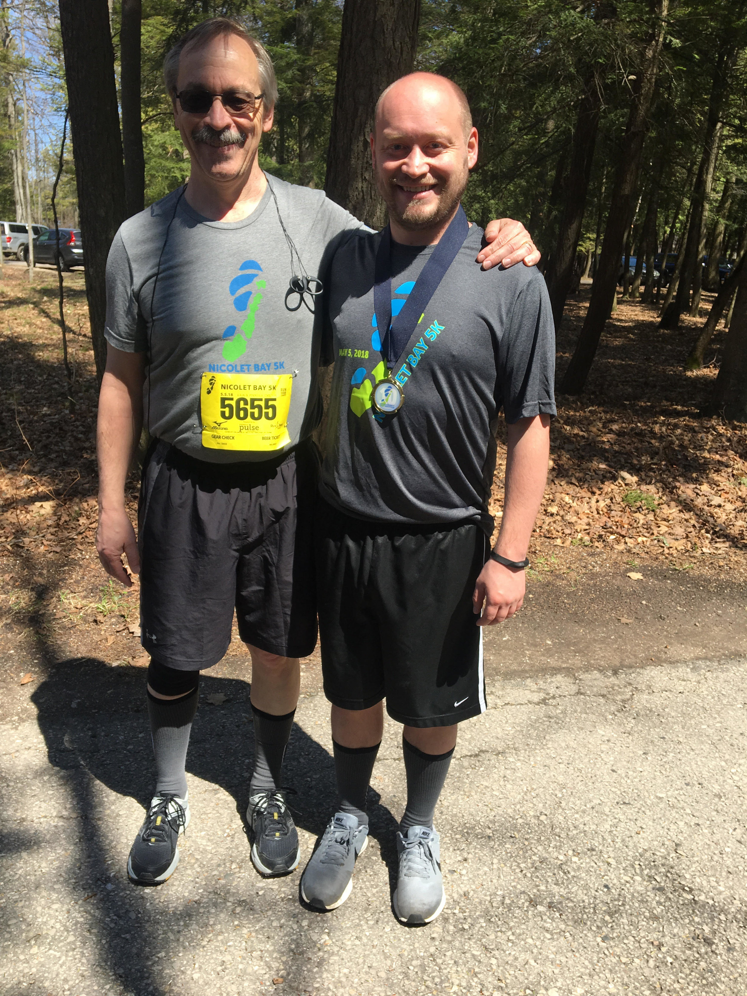 Fab 60! - John Schopf Sr. (left) and John Schopf Jr. (right) ran their 60th race together at the Hey Hey 5K in Baileys Harbor on Sept. 22. Way to go, John and John!