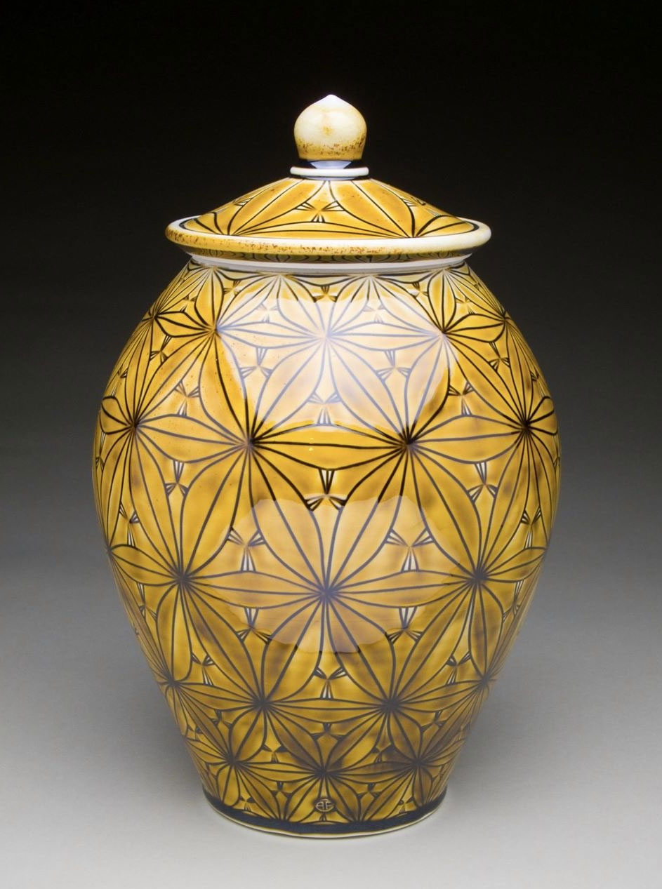 """Covered Jar   2014  Porcelain with Carved Pattern and Amber Celadon Glaze  16x19x9"""""""