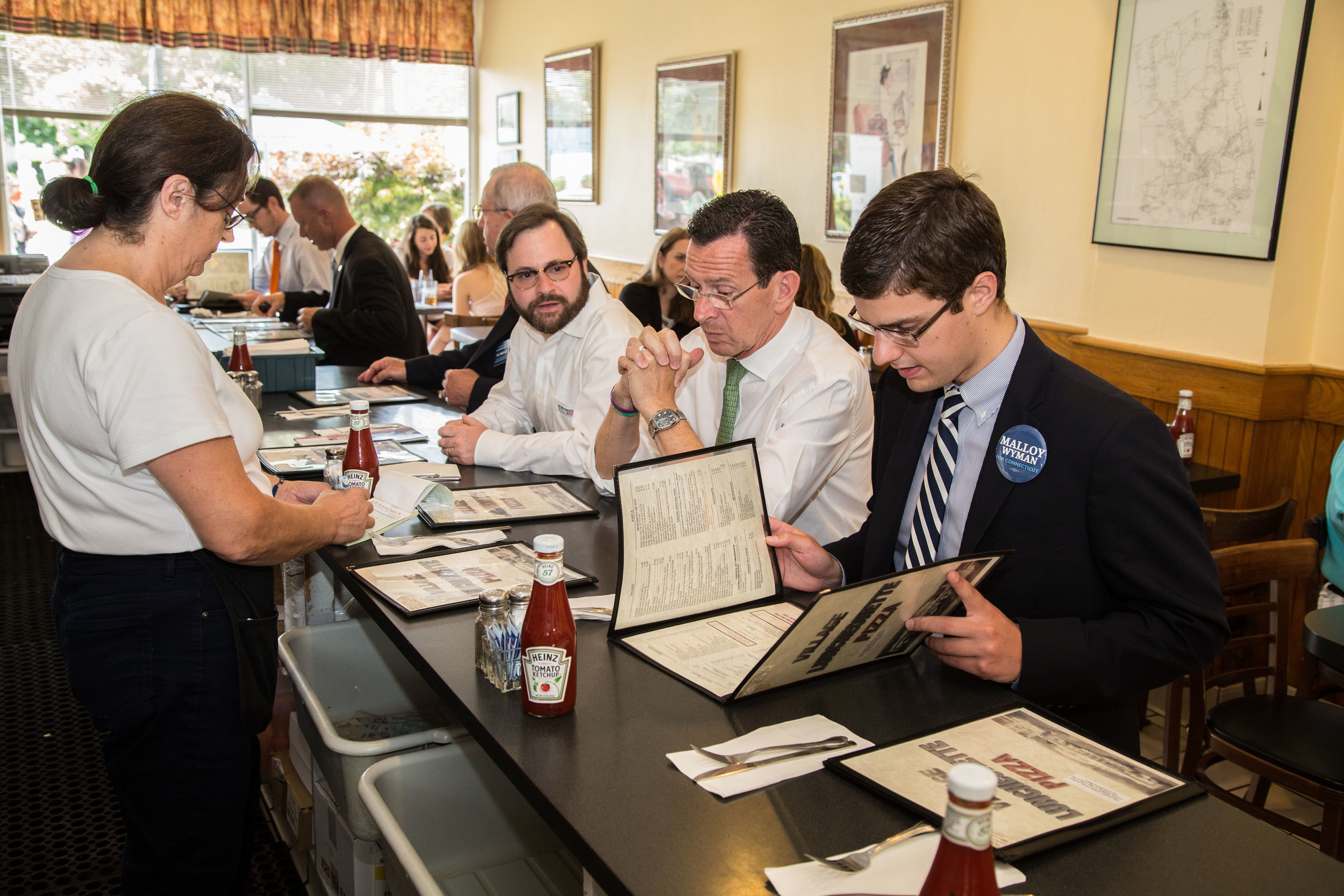 Connecticut Governor Dannel Malloy eats in Wilton, Conn.