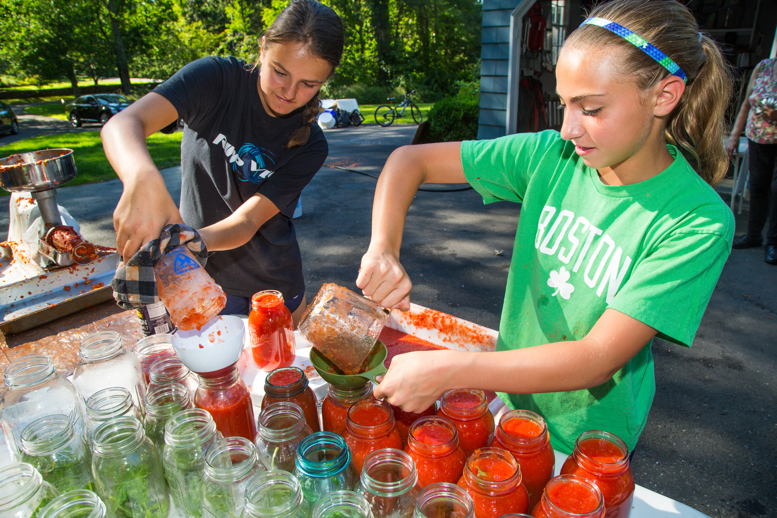 Two young girls 'doin tomatoes' in Wilton, Conn.