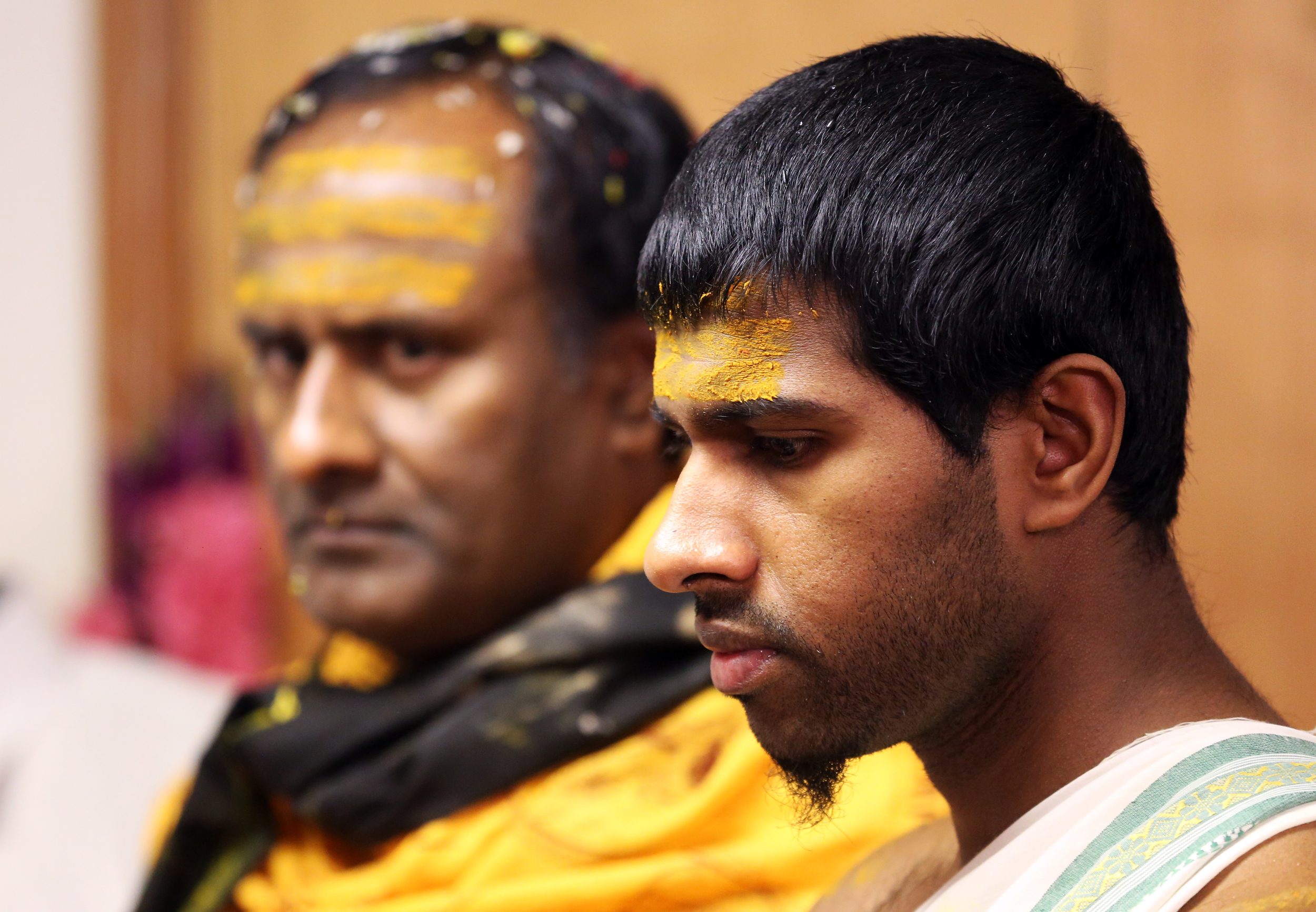 Two Hindu men during a traditional service at a temple in Wilton, Conn.