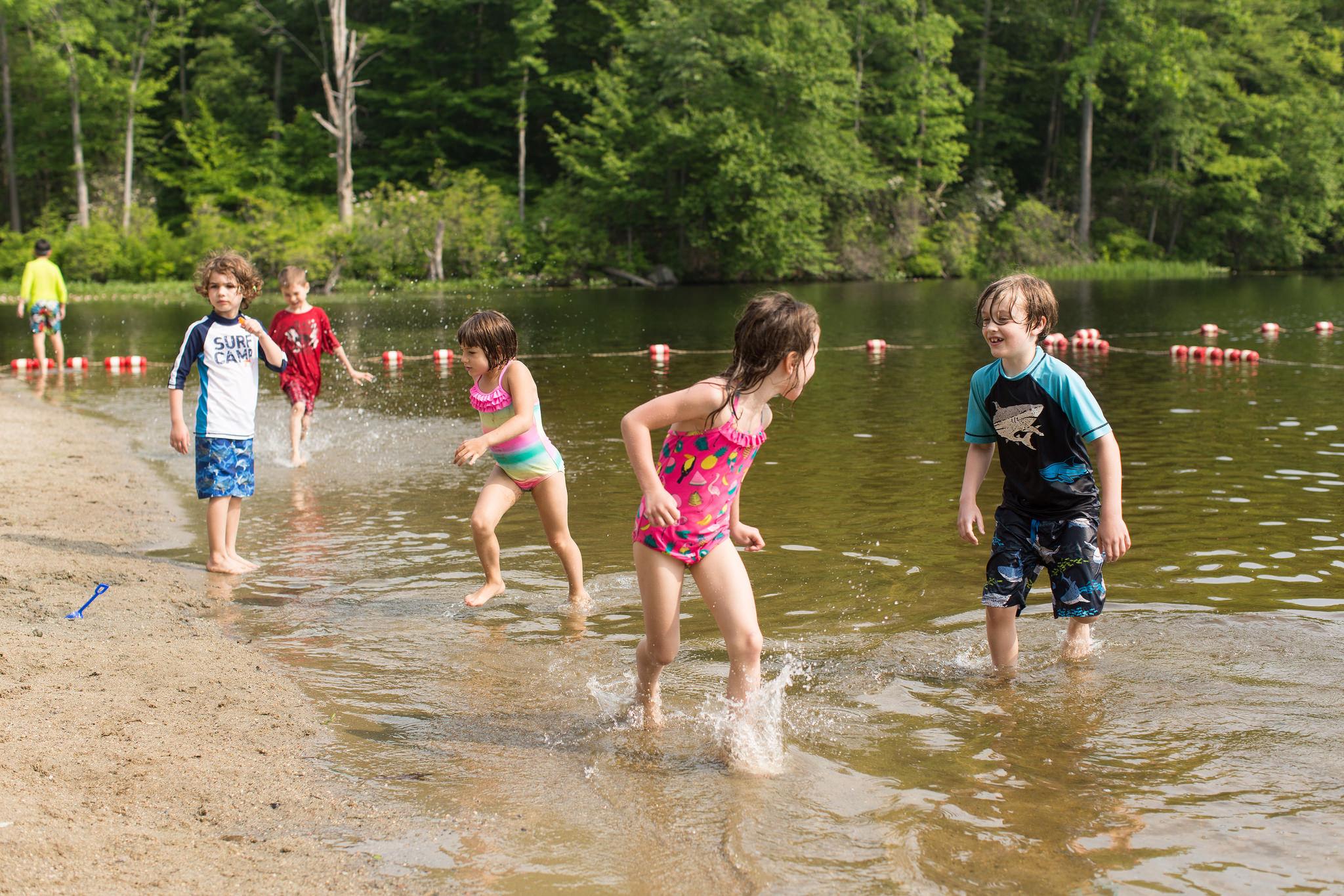 Children enjoy the water at Redding's Topstone Park.