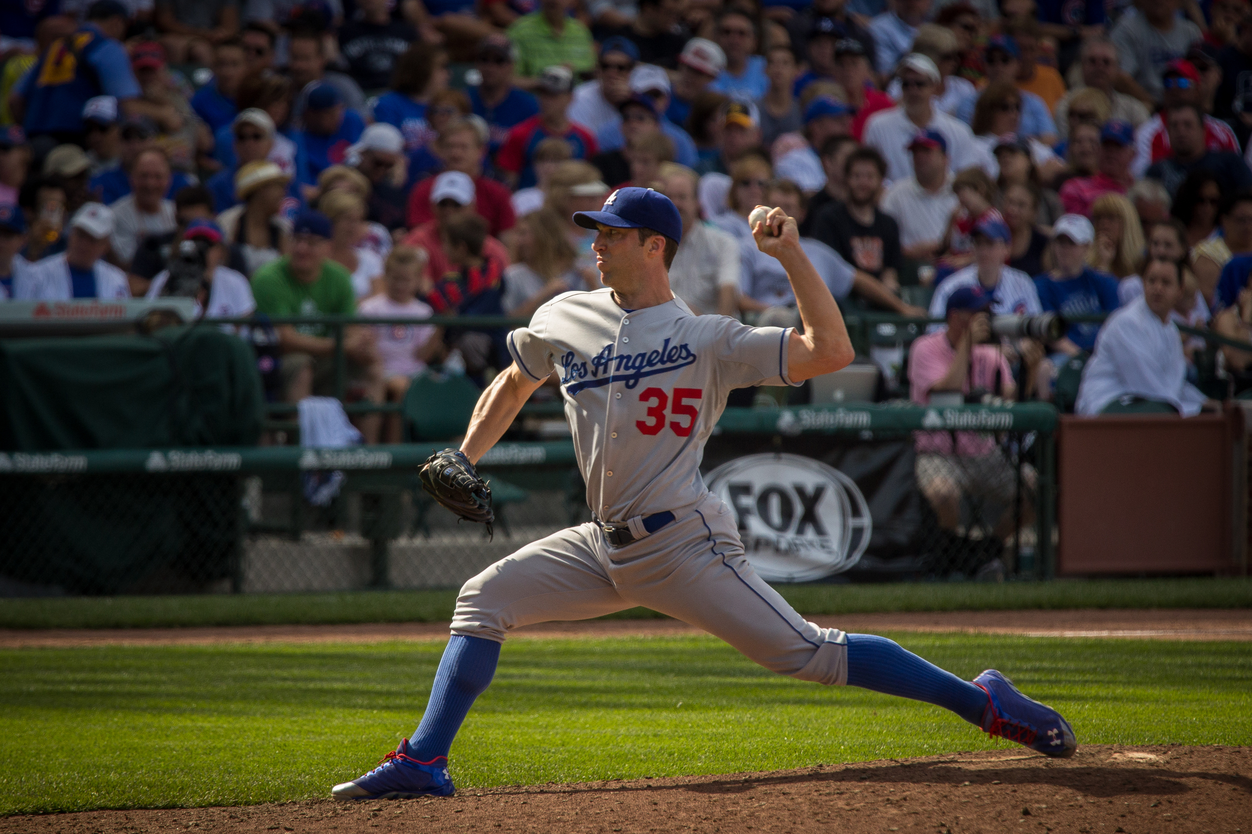 Chris Capuano pitches for the Los Angeles Dodgers against the Chicago Cubs at Wrigley Field