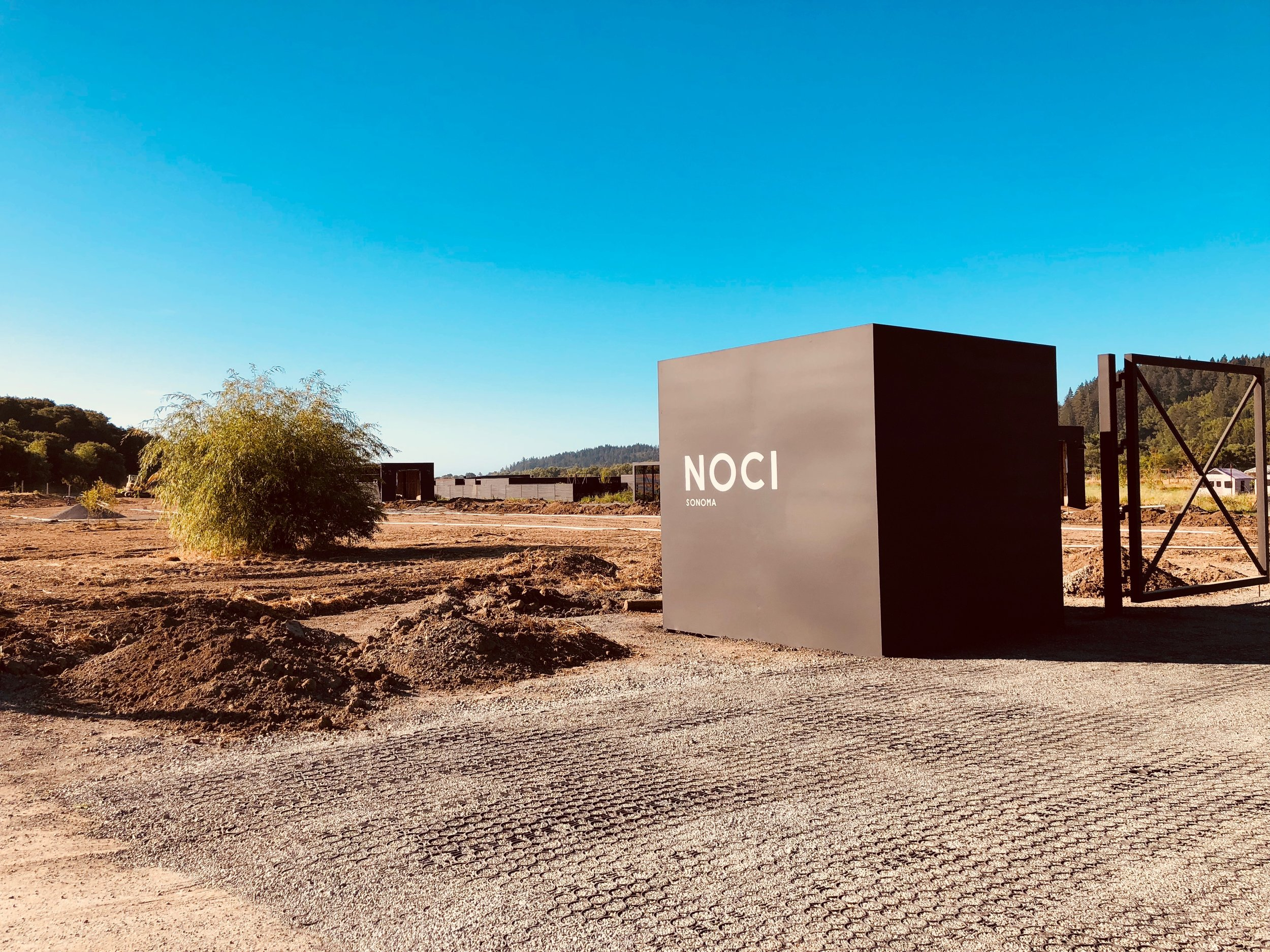 The new Noci gates and our new logo. The gates will get plants and trees around them next week and look more complete. But we are already excited just seeing the raw box sitting in the dirt.