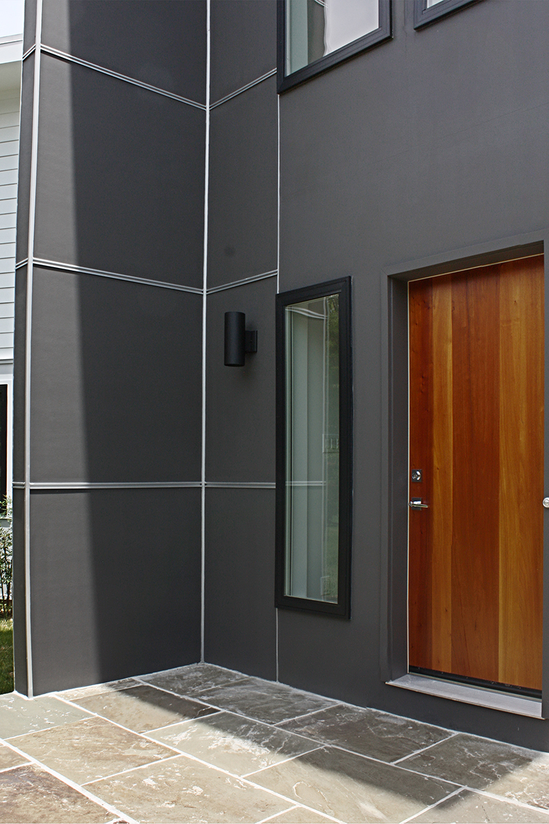 Fiber cement panels with aluminum reveals.  Potomac Contemporary Addition.