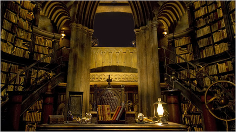 Dumbledore's office, during the tour of this, Harry, Ron, and Hermonie are in Harry's invisibility cloak. It was pretty rad hearing those characters again!