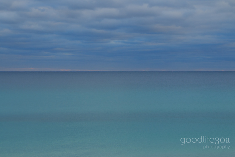 beachscapes - white clouds over green water.jpg