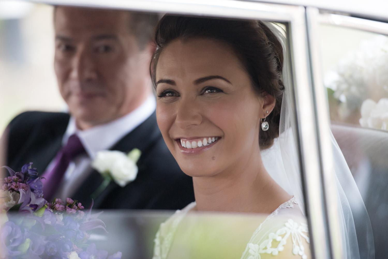Bride and her father arriving at Rockingham Castle wedding