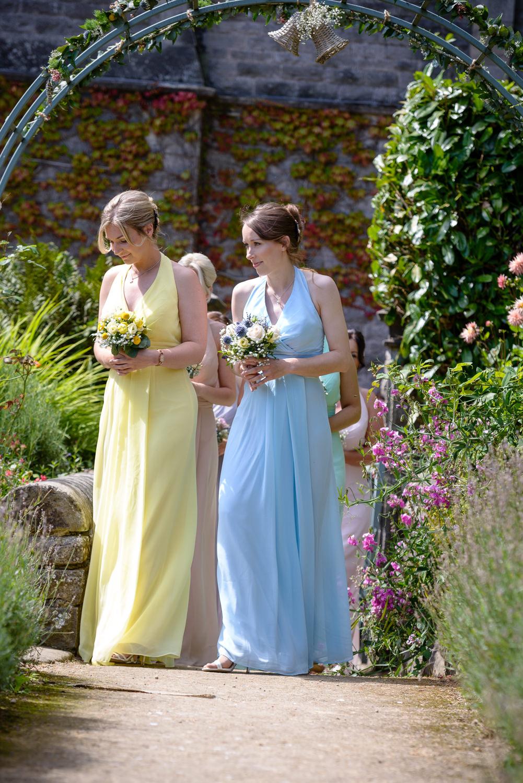 bridesmaids walking down the aisle at callow hall wedding