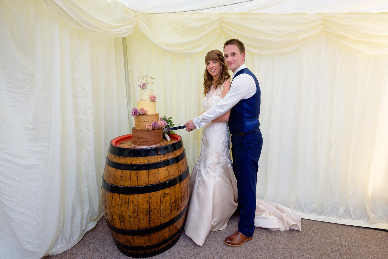 Bride and grrom cut wedding cake at Callow Hall wedding