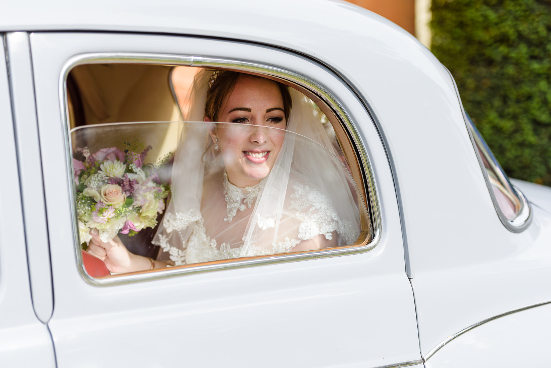 Bride arriving at Langar Hall for her wedding