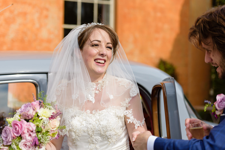 Bride arrives at Langar Hall wedding
