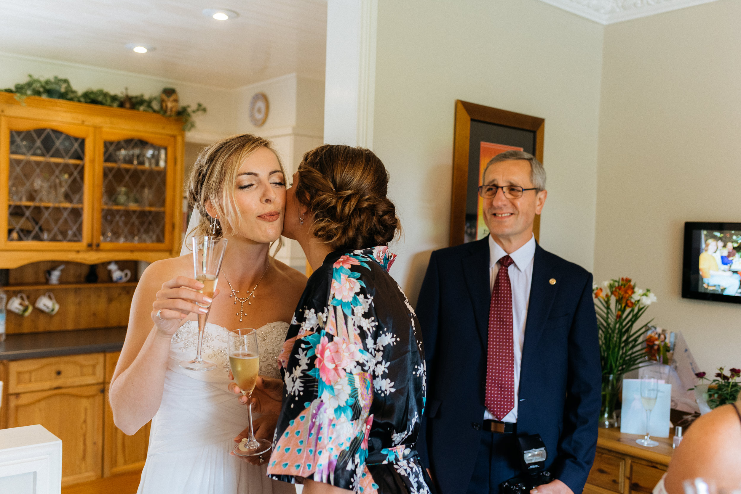 Bride drinking champagne with her family