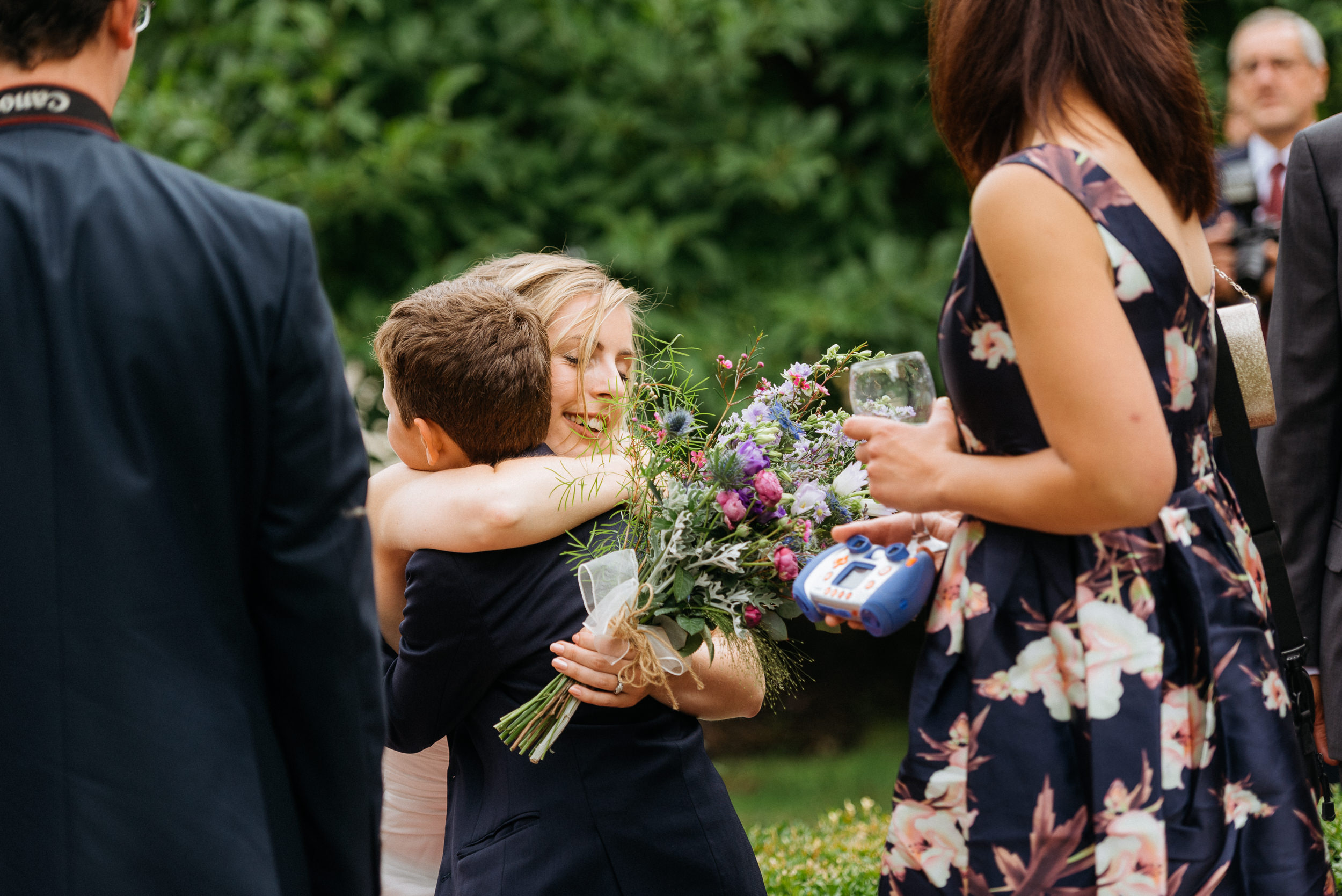 Bride hugs a young guests