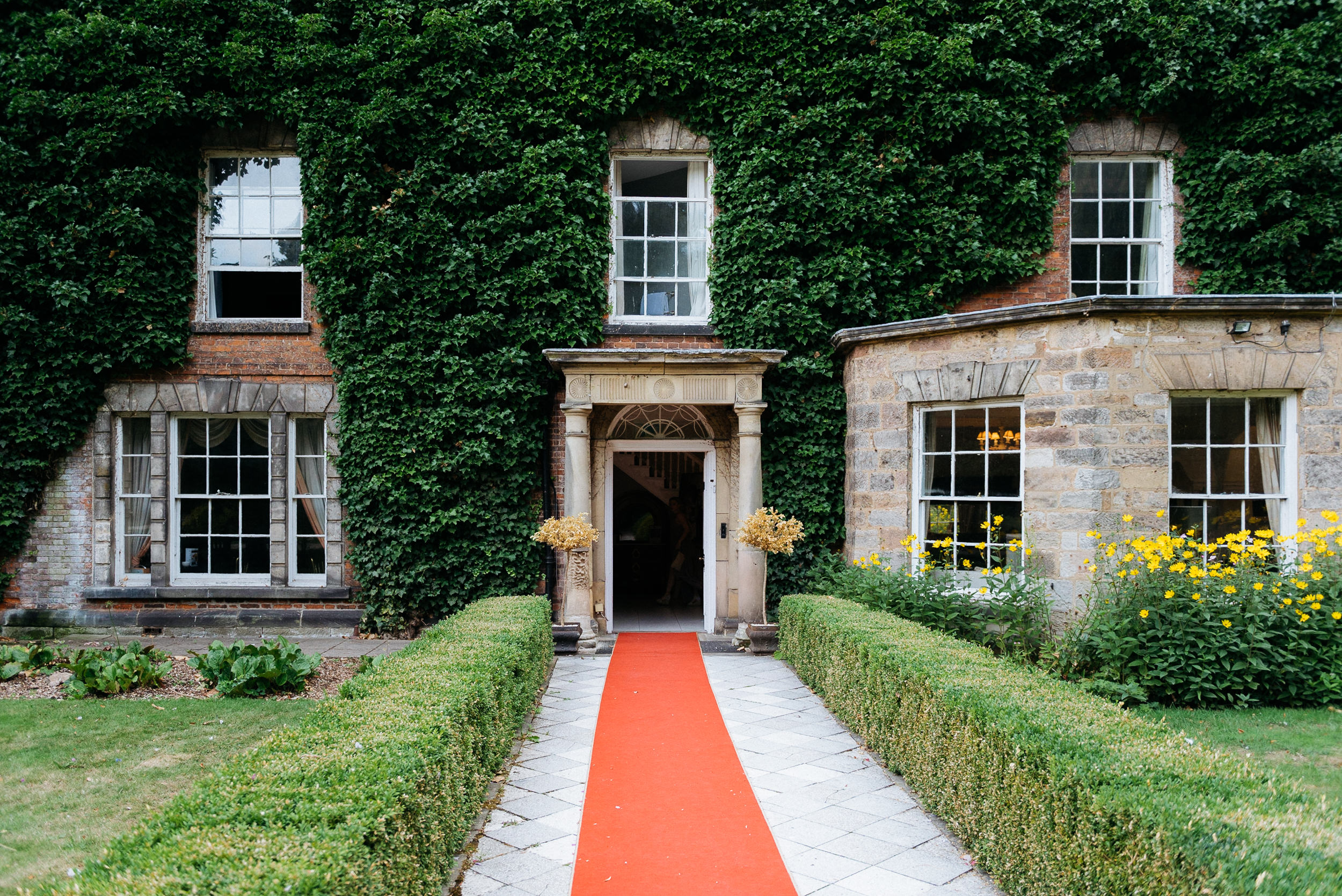Red carpet at Risley Hall wedding