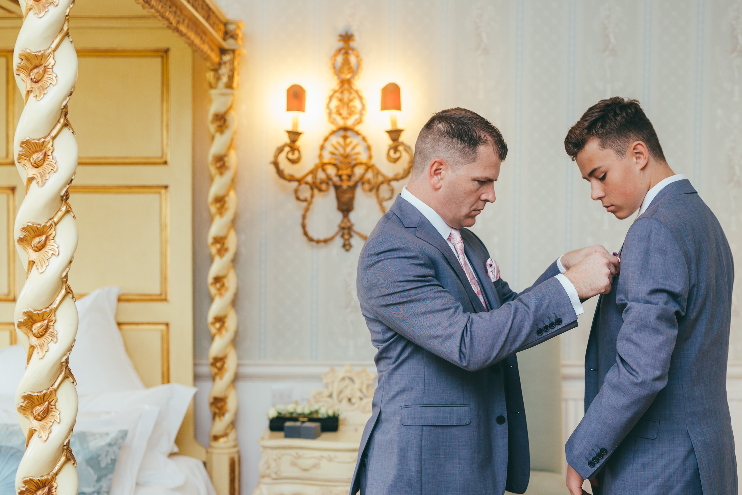 Groom and his usher getting dressed