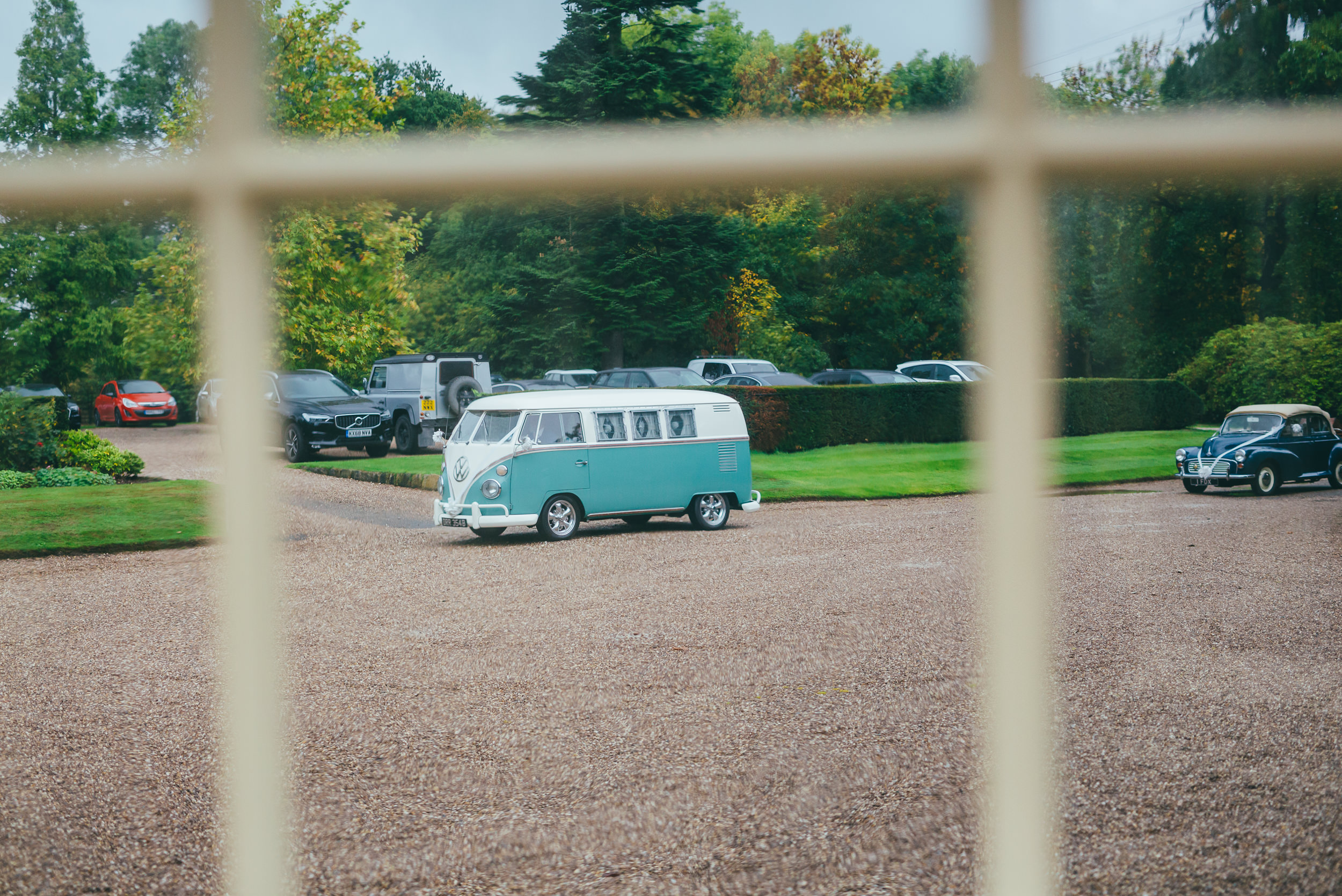 Bridesmaids arrive at Norwood Park in a VW campervan