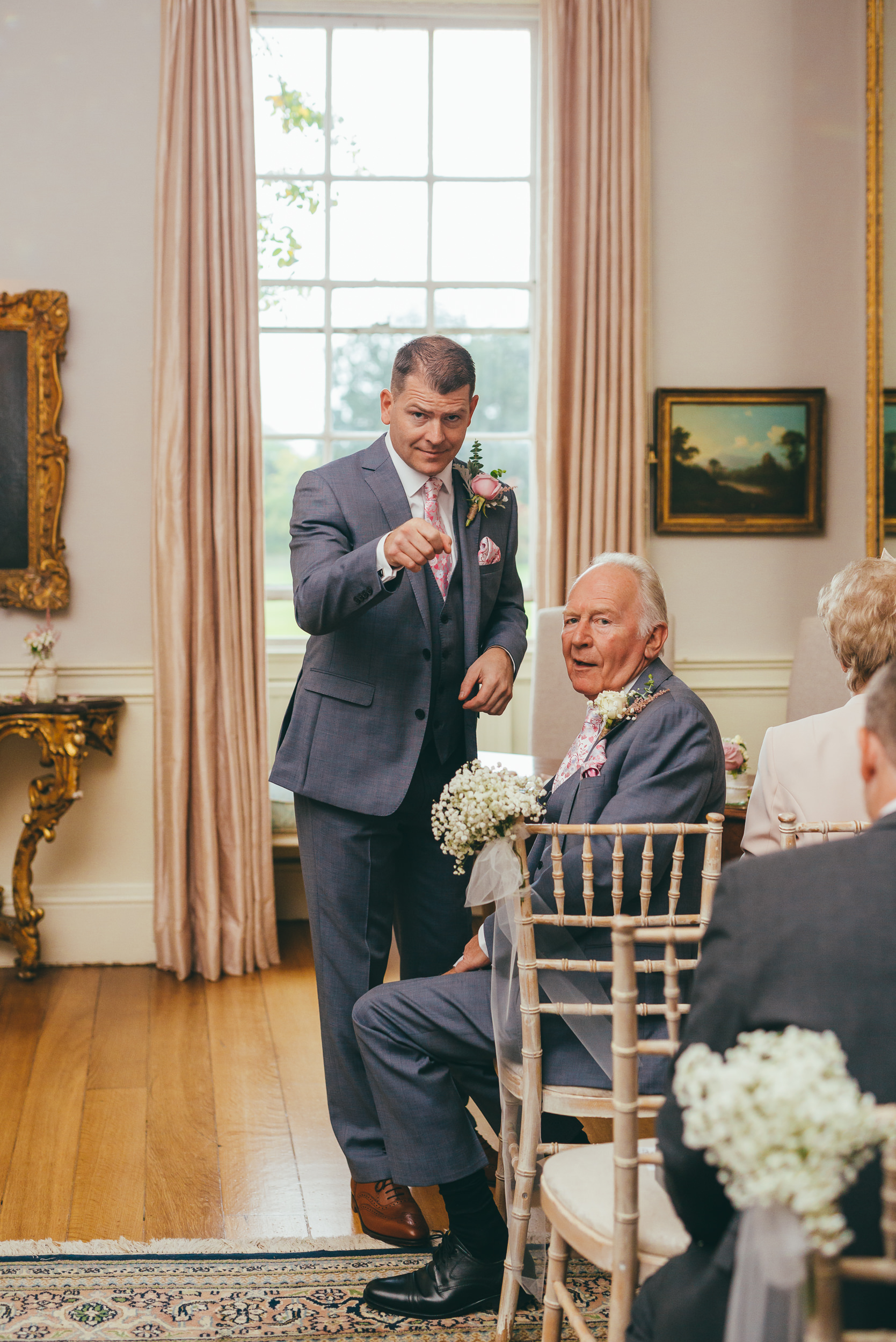 Groom pointing