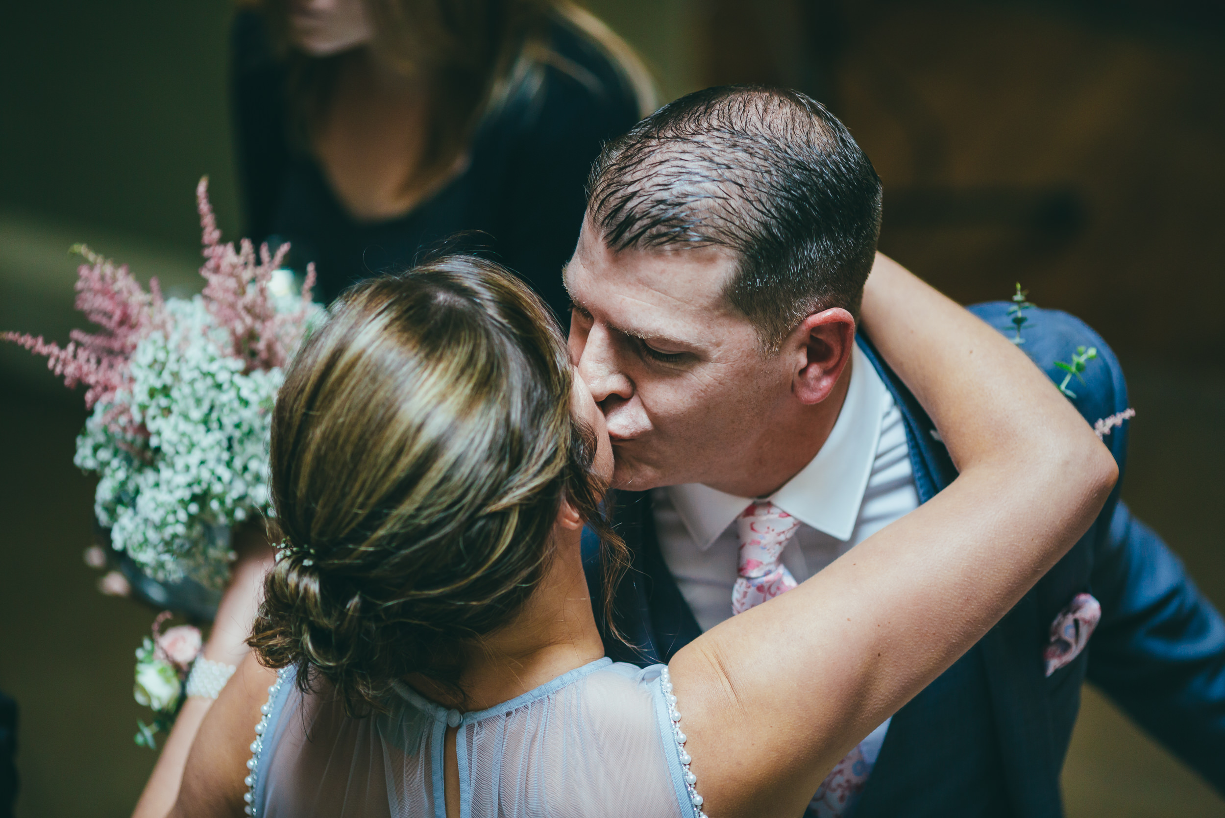 Groom kissing
