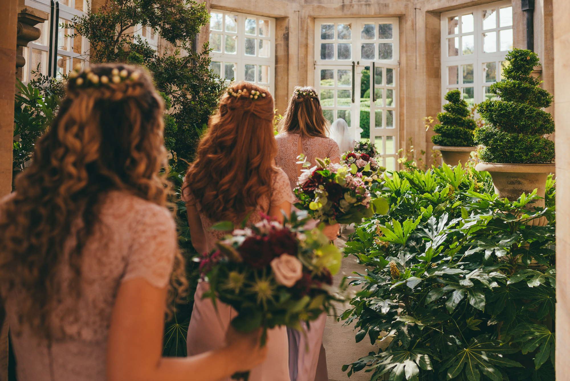 bridesmaids walking through the conservatory