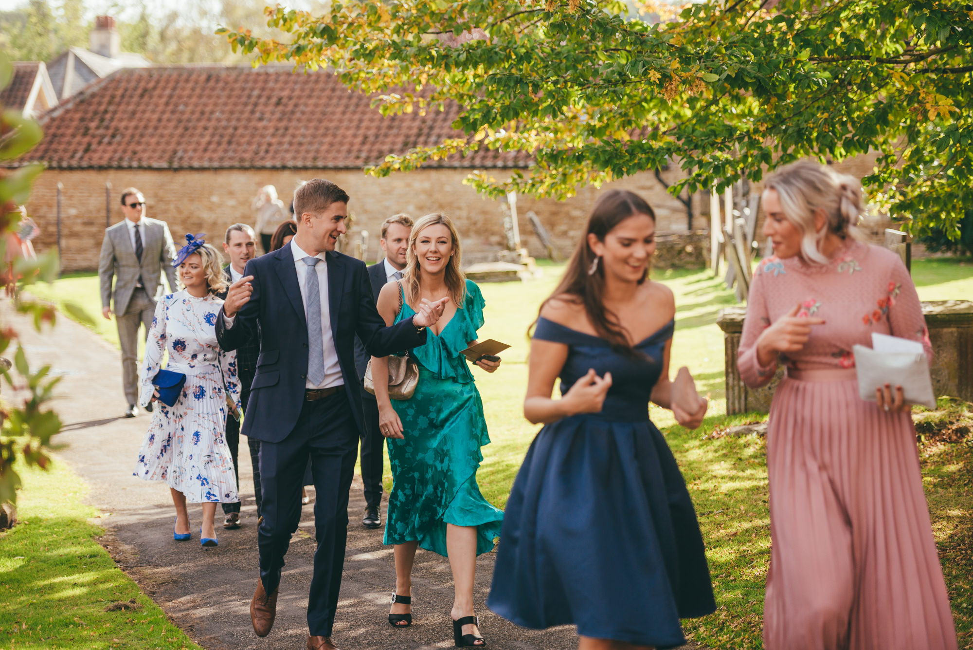 wedding guests walking into church