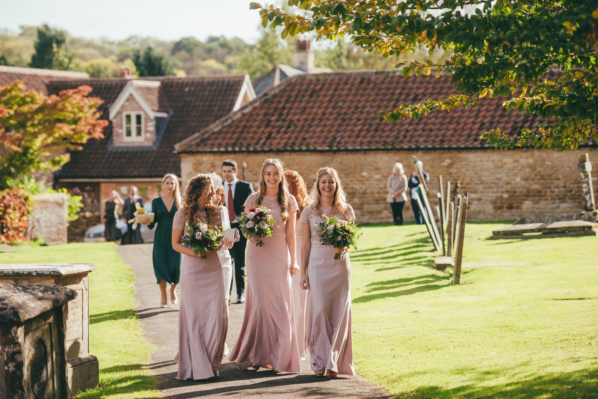 bridesmaids arriving at harlaxton manor church