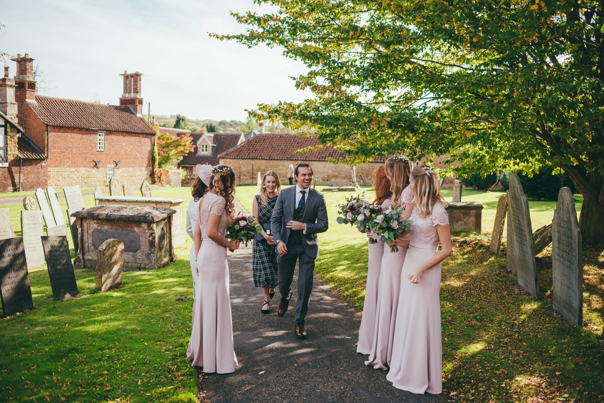 bridesmaids greeting wedding guests