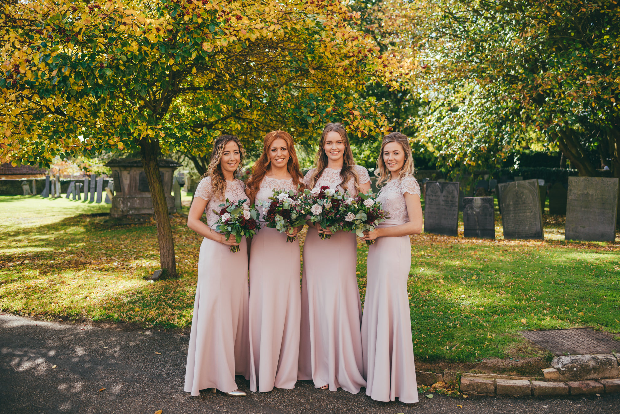 portrait of the bridesmaids at harlaxton church